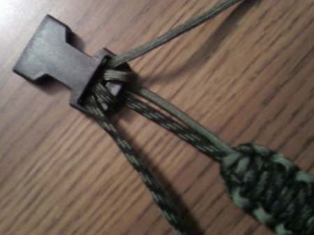 You should have 2-3 feet of paracord left.  Previously, we stopped the braid a few inches short.  That's because this is your room to shrink!