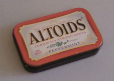 My Altoids survival tin, wrapped in 6 feet of electrical tape for waterproofing and survival use.