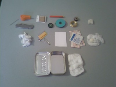 All the contents of my survival tin, minus the fish hooks.